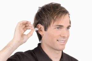 how to insert ear plugs