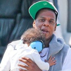 Jay-Z's doughter wearing Baby Banz ear muffs