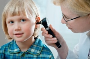 examining childs ear for hearing loss